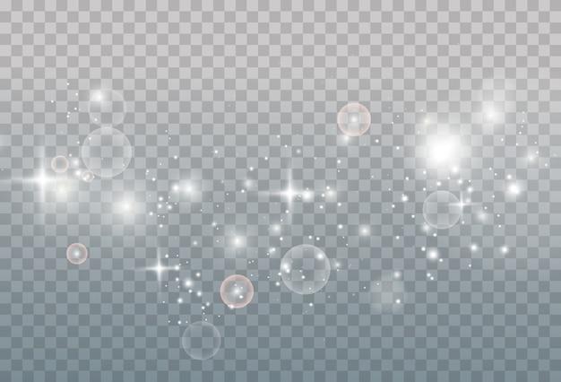 Polvere magica scintillante. su uno sfondo bianco e nero materico. celebrazione astratto di particelle di polvere di luce e argento scintillanti e stelle. effetto magico.