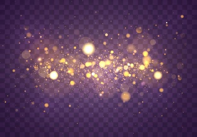 Polvere magica scintillante e particelle d'oro. effetto bokeh astratto.