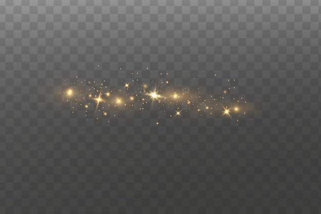 Scintillanti particelle di polvere magica. le scintille di polvere e le stelle dorate brillano di luce speciale.