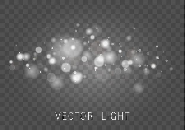 Polvere magica scintillante e particelle bianche su sfondo trasparente.