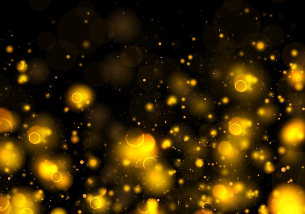 Scintillanti particelle di polvere giallo oro magico. effetto bokeh.