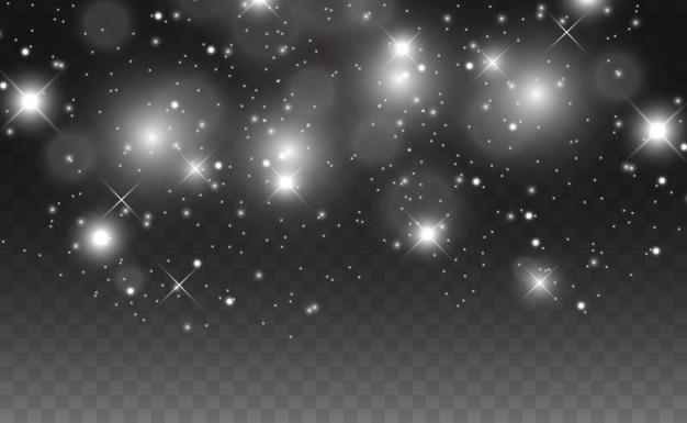 Scintille e stelle dorate scintillano con un effetto di luce speciale. brilla su sfondo trasparente. . scintillanti particelle di polvere magica