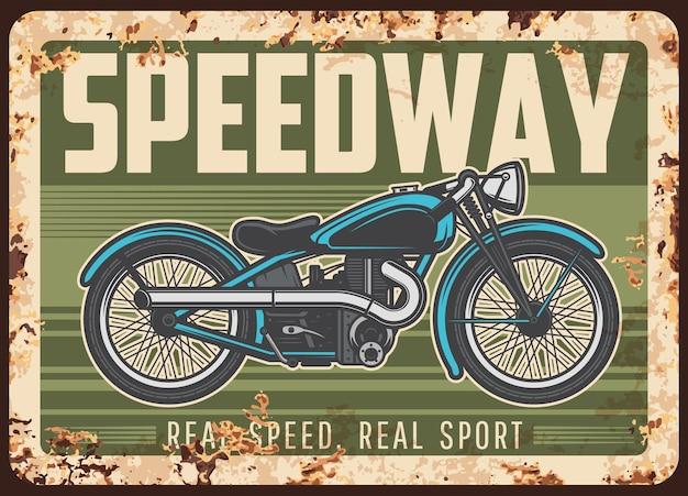 Piastra arrugginita speedway con moto d'epoca