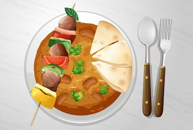 Curry indiano piccante con kebab