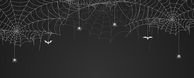 Banner di ragnatela con ragni e pipistrelli appesi, sfondo di ragnatela, spazio di copia