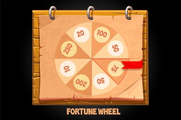 Gira la ruota di carta della fortuna su una tavola di legno.