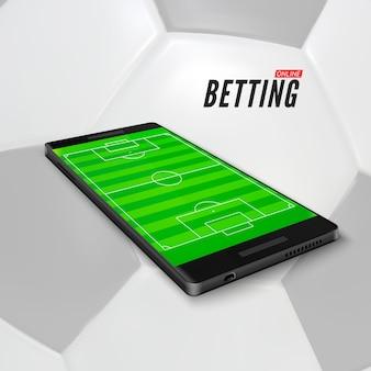 Scommesse sportive online in app sul cellulare. campo di calcio sullo schermo dello smartphone. banner di scommesse sportive su sfondo di pallone da calcio.