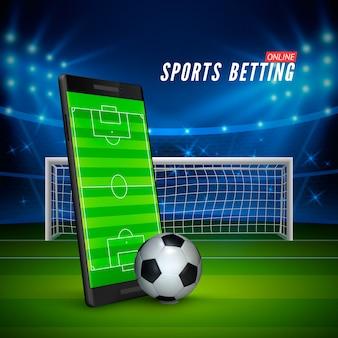 Scommesse sportive online. telefono cellulare con campo da calcio sullo schermo e pallone da calcio realistico di fronte. stadio di calcio sullo sfondo.