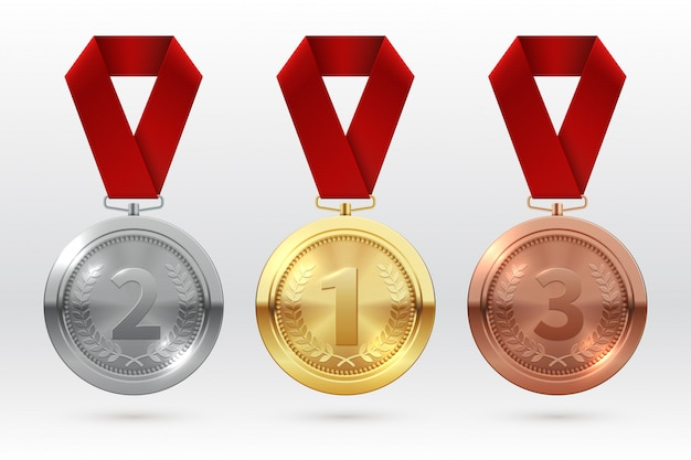Medaglie sportive. medaglia di bronzo argento dorato con nastro rosso. premi campione vincitore del modello isolato onore