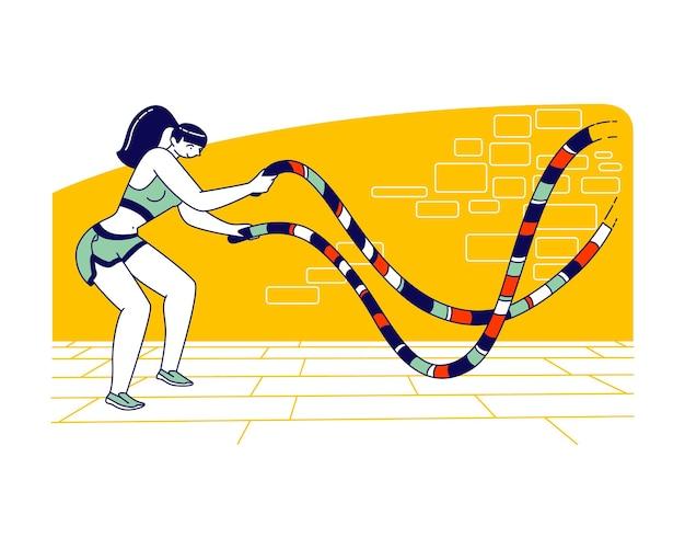 Carattere di sportiva con corda da battaglia facendo allenamento incrociato fitness funzionale in palestra.