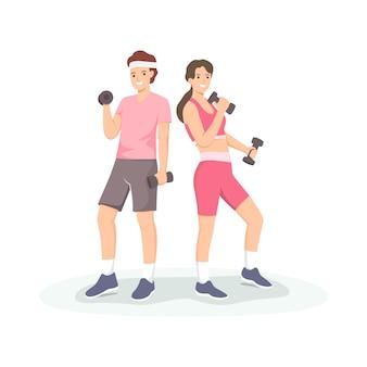 Coppia sportiva sollevamento manubri insieme