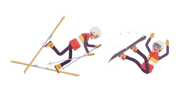 Uomo sportivo che cade in cattiva tecnica sulla stazione sciistica