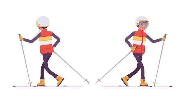 Uomo sportivo sci, gode di attività invernali all'aperto sulla stazione sciistica
