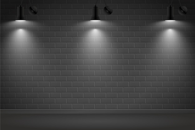 Luci spot su sfondo scuro muro di mattoni