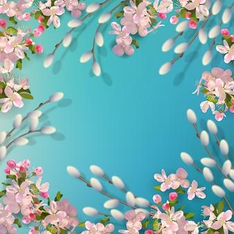 Sfondo di primavera con rami di salice e fiori di ciliegio