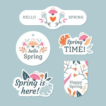 Collezione di badge primavera con fiori e foglie colorate