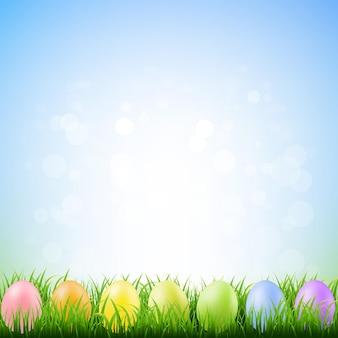 Erba di primavera con le uova di pasqua con l'illustrazione della maglia di gradiente