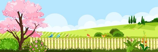 Paesaggio primaverile con prato di erba, albero in fiore di sakura, siepe, colline, cielo, nuvole.