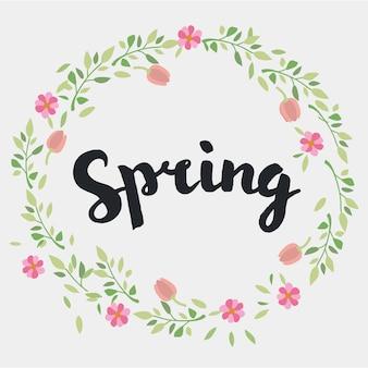 Lettering primavera con ghirlanda decorativa floreale di foglie e fiori.