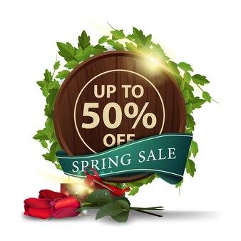 Modello di banner moderno di vendita di primavera con rose con regalo