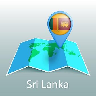 Mappa del mondo di bandiera dello sri lanka nel perno con il nome del paese su sfondo grigio