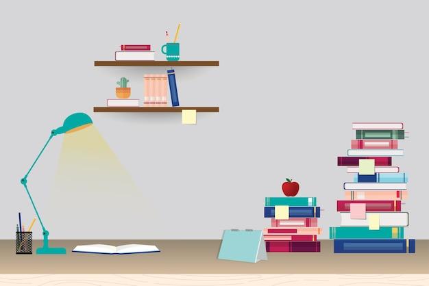 Pila di libri e articoli di cancelleria sul tavolo e scaffali