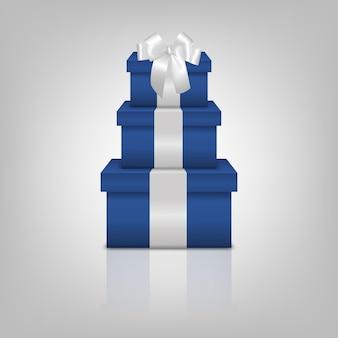 Pila di tre scatole regalo blu realistiche con nastro bianco e fiocco