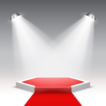 Palco per la cerimonia di premiazione con faretti. podio bianco con tappeto rosso. piedistallo. scena esagonale. .
