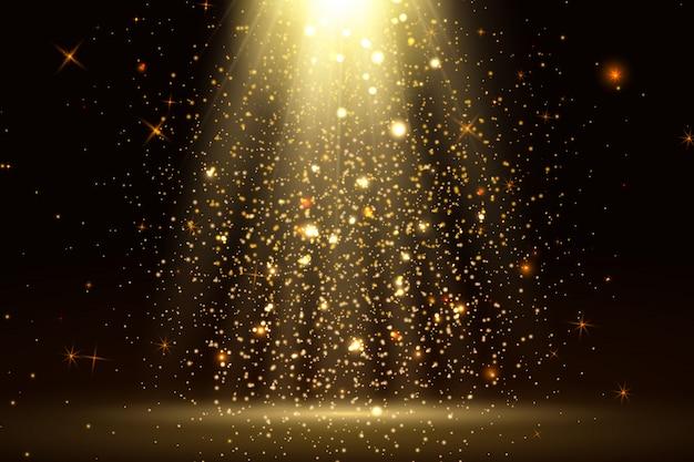 La luce del palcoscenico e le luci dorate scintillano con raggi dorati, travi e polvere scintillante che cade sul pavimento. astratto sfondo oro per visualizzare il tuo prodotto. faretto o palcoscenico lucido.