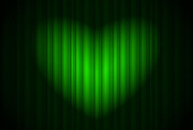 Palcoscenico con tenda verde e riflettori grandi, a forma di cuore