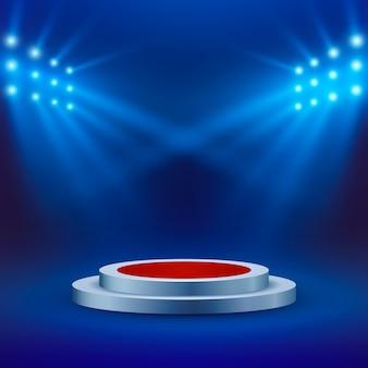 Palco con tappeto rosso e riflettori su sfondo blu. arena o scena del concerto. podio vuoto.