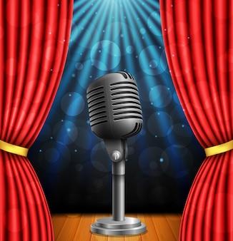 Stage con curtians rossi, microfono e riflettori.