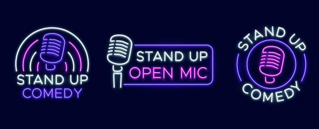 Segni di spettacolo in piedi. club di commedia al neon e icone del microfono aperto. intrattenimento comico e simboli vettoriali di eventi. illustrazione stand up commedia e umorismo, cartello con microfono