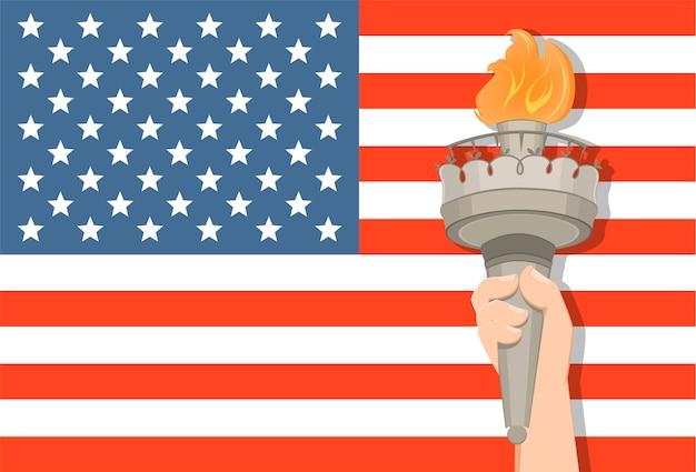 Mano della statua della libertà con la torcia e la bandiera di usa