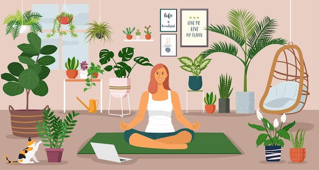 Soggiorno a casa concetto, giovane donna che ha lezioni di yoga durante una videochiamata a casa decorata con piante d'appartamento