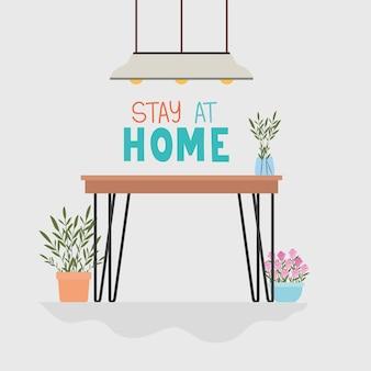 Resta a casa scritte e tavolo, sedie, rose, lampadario