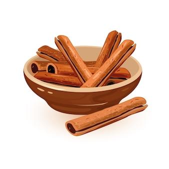 Bastoncini di cannella sono in una ciotola di ceramica marrone
