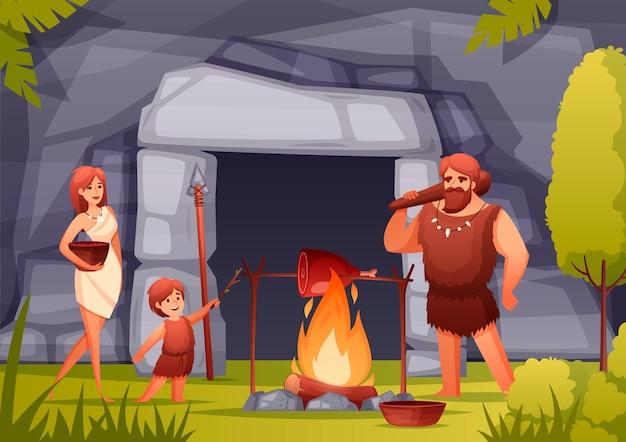 Famiglia preistorica dell'età della pietra che cucina carne su fuoco aperto davanti all'illustrazione piana della composizione dell'entrata della caverna