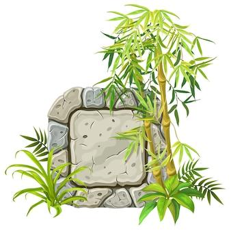 Tavola di pietra con rami di bambù, foglie.