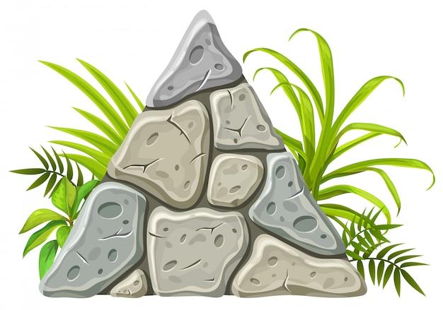 Bordo di pietra con foglie tropicali ed erba.