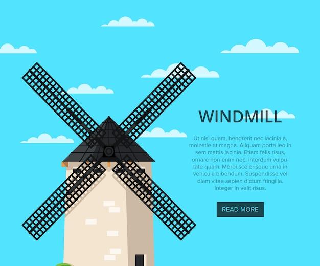 Vecchio mulino a vento pietroso sul fondo del cielo blu