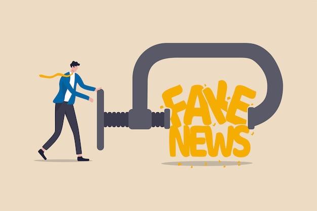 Fermare le notizie false e la disinformazione che si diffondono su internet e il concetto di media, il leader dell'uomo d'affari che spreme e distrugge la parola fake news.
