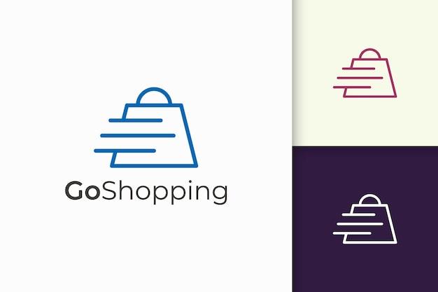 Logo del negozio in modo semplice e moderno con la combinazione di borsa e forma effetto velocità