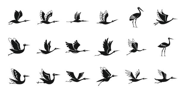 Le icone dell'uccello della cicogna hanno messo il vettore semplice. mosca dell'uccello. cicogna appena nata