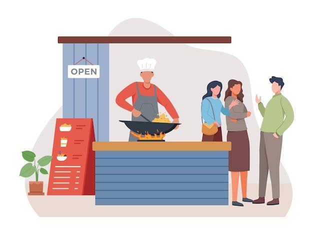 Venditore di cibo di strada che frigge riso fritto