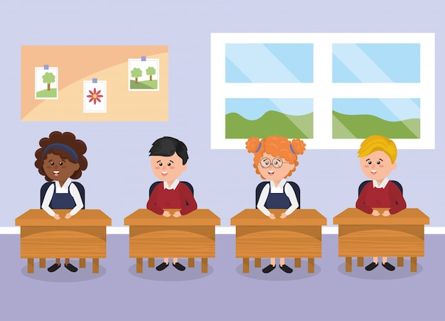 Bambini studenti con banco di scuola in classe