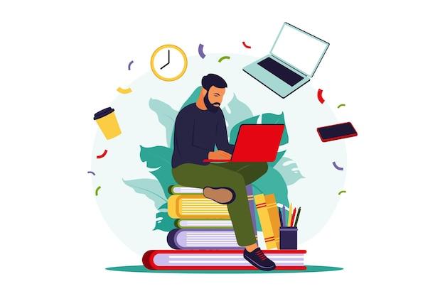 Uomo dell'allievo con il computer portatile che studia sul corso in linea. concetto di formazione online.