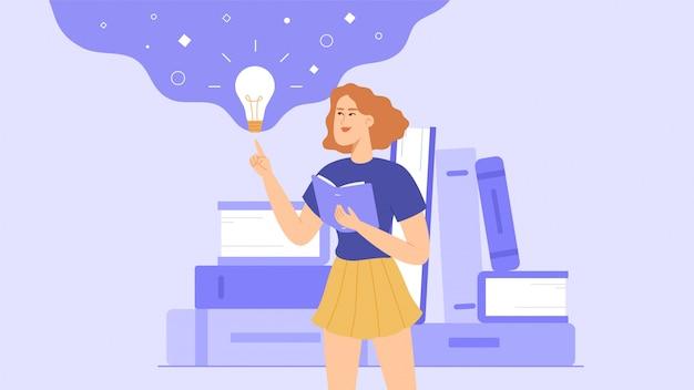 Uno studente o una scolara legge un libro. durante la lettura, la ragazza ha un'idea. una pila di libri è sullo sfondo.