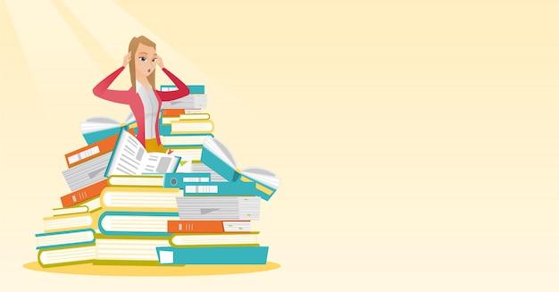 Studente seduto in una pila enorme di libri.