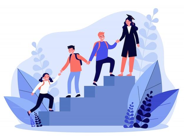 Studenti che si aiutano a vicenda per salire le scale
